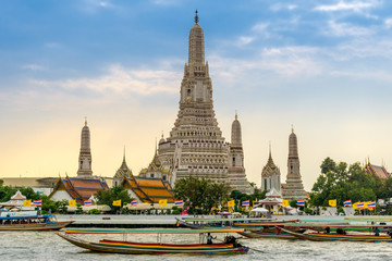 Longtail boats on the Chao Phraya River at the Temple of Dawn, Wat Arun, Bangkok