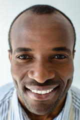 Portrait of cheerful afro american man smiling