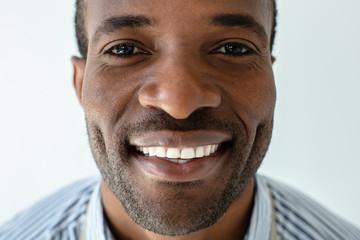Portrait of joyful afro american man against white background