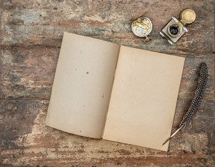 Open book antique office supplies wooden background flat lay