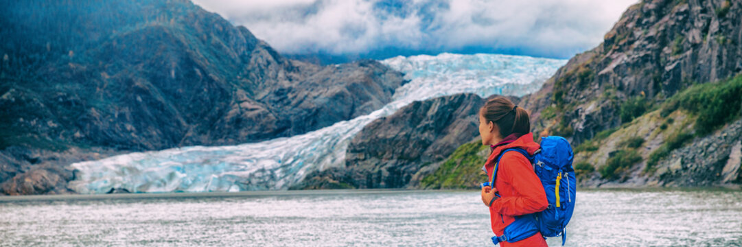 Alaska glacier travel destination Mendenhall tourist attraction in Juneau, USA. Woman walking at ice landscape background panoramic.