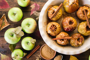 Baked Apples on a Wooden Background Cinnamon Anise and Autumn Leaves