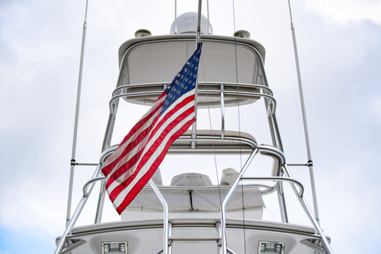 American flag attached to the luxurious yacht