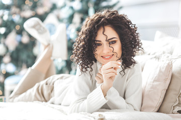 Close up portrait of beautiful woman on christmas background