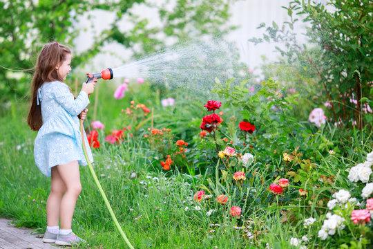 Mothers little helper having fun in the garden