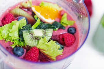 Fresh raw berries and fruits in blender
