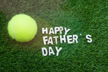 Happy Father's day to Tennis player on green grass