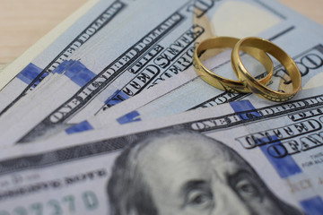 wedding gifts to the newlyweds at the wedding, money (Dollars) and wedding rings