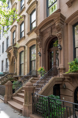 Side view of an ornate brownstone building in an iconic neighborhood of Brooklyn in New York City