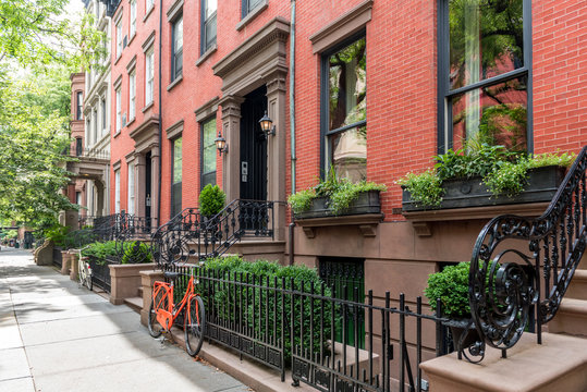 Two bicycles in front of a brownstone building in neighborhood of Brooklyn Heights, New York