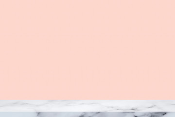 white marble table with pink wall background.