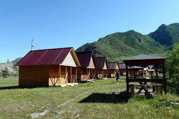 Tourist base on the banks of the mountain river Big Yaloman. altai republic