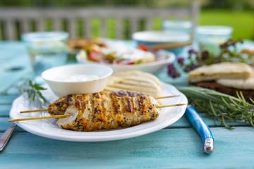 Delicious grilled chicken souvlaki, traditional Greek dish.