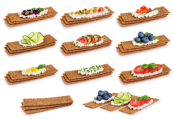 Crispbread with cheese, vegetables, jam and berries isolated on white background. Сollection.