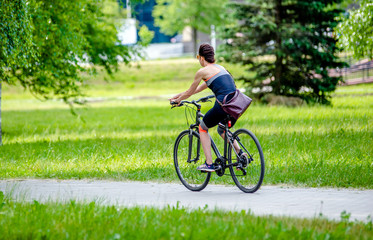 Girl riding a bike in the city Park