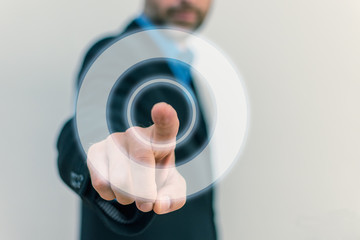 Men in Business suit touching circled button