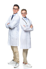 doctors standing with crossed arms and looking at camera isolated on white