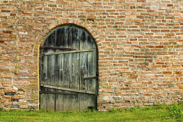 Old wooden door in a brick building