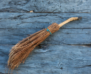 witch broom on a wooden background