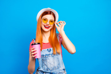 People youth youngster person lifestyle concept. Close up studio photo portrait of attractive pretty cute trendy lovely cheerful excited lady holding paper cup in hand isolated bright background