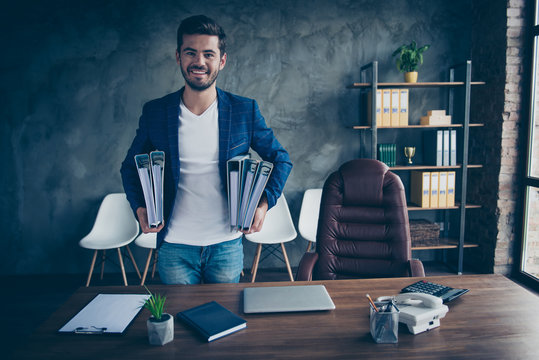 Being an accountant is easy! Confident man happily looks into the camera holding a folder of papers, which he prepared for the tax