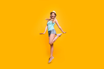 Full-size portrait of lovely girl in headwear jump and fun isolated on shine yellow background with space for text