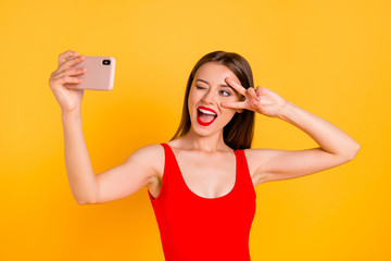 Modern technology people person good mood concept. Photo portrait of screaming with open mouth cool swag pretty lady taking making selfie isolated on bright vivid background