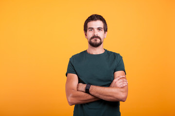 Serious man isolated on orange background. Confident person looking in the camera Fototapete
