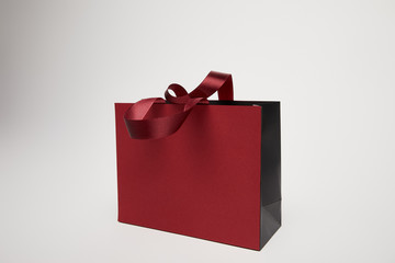 one new burgundy shopping bag isolated on white
