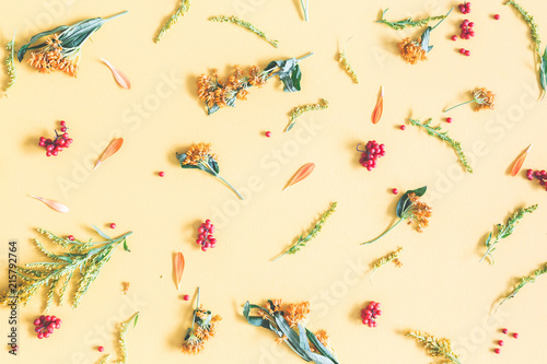 Autumn composition pattern made of orange and yellow flowers on pattern made of orange and yellow flowers on pastel yellow background autumn mightylinksfo