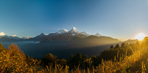 Panorama of the Annapurna mountain range in the Himalayas, from Poon Hill trek viewpoint in Nepal.