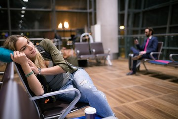 Woman relaxing in waiting area