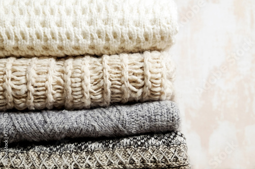 Bunch Of Knitted Warm Pastel Color Sweaters With Different Knitting