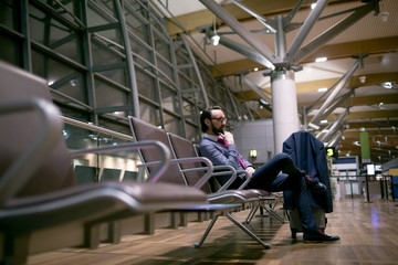 Businessman waiting in waiting area at airport