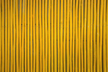 Pattern of yellow wooden wall for background.