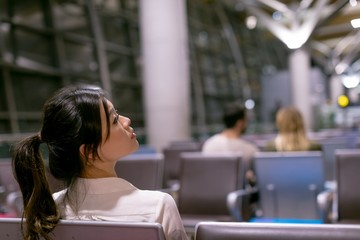 Woman waiting in waiting area at airport