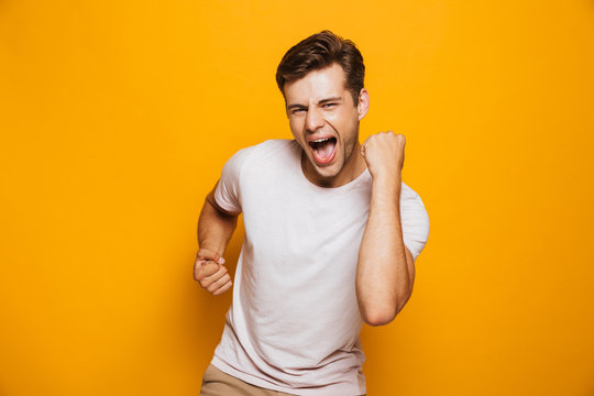 Portrait of a cheerful young man celebrating