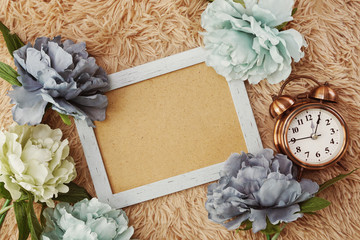 space copy on photo frame and flower mock up flat lay