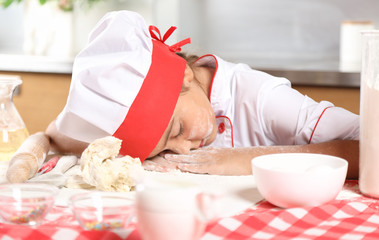 Little girl sleeping at the kitchen table