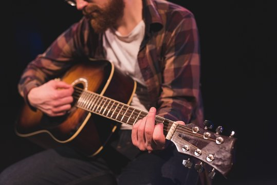 Man playing guitar on stage