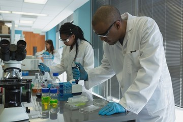 Scientists doing experiment in lab