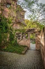 Old city yard, trees, stone facade, Nuremberg