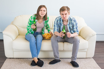 Soccer world cup concept - Modern couple looking excited and happy watching sport game on tv