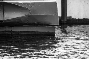 The rudder of the submarine in the water is close