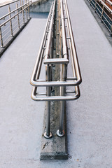 Concrete ramp way with stainless steel handrail