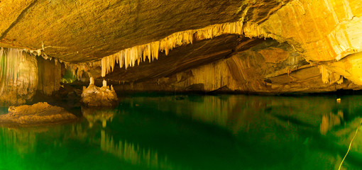Flooded Crocodile Cave, with geological formation and salt water, in Koh Tarutao Island, Southern Thailand.