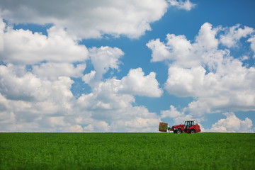 Wall Mural - Red tractor transporting straw bales