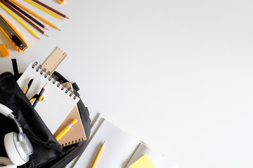 Back to school. Items for the school supplies on white table ready for your design
