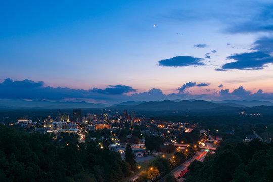Twilight scene overlooking Asheville, a destination vacation mountain town in western North Carolina