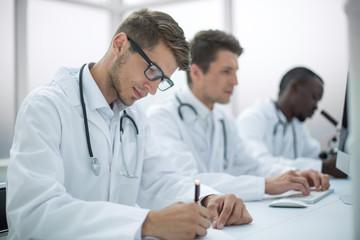 group of doctors conducting laboratory studies